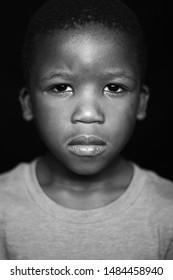 Black and white portrait of black boy