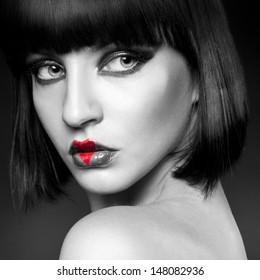 black and white portrait of brunette heart on lips in studio