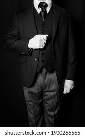 Black and White Portrait of Butler or Servant in White Gloves on Black Background. Service Industry. Professional Hospitality and Courtesy. Formal White Glove Service