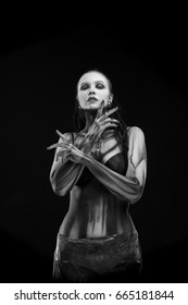 Black and white portrait of a character for computer game Body painting skeleton cyborg, woman with pattern on body on black background