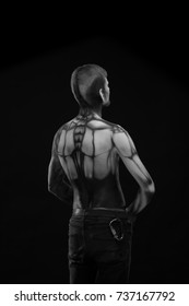 Black and white portrait, Character for computer game Bodyart cyborg, male with pattern on body on black background