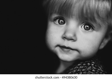 Black and white portrait of a cute little girl.