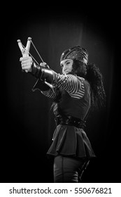 black and white portrait of a emotional actress woman in a pirate costume on a black background