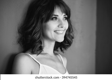 Black and white portrait of an excited beautiful woman