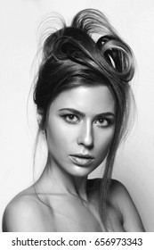 Black and white portrait of a girl with makeup and beautiful hairstyle high