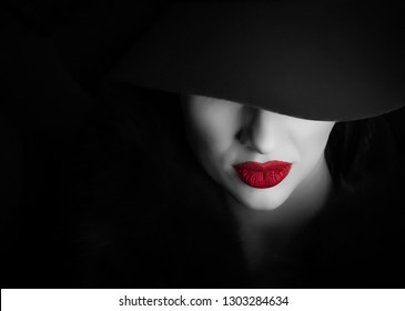 Black and white portrait of a girl with a red lipstick on her lips