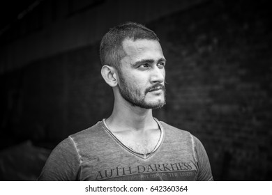 Black and white portrait of a handsome guy against a black background