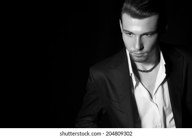 Black and white portrait of handsome man.Black background