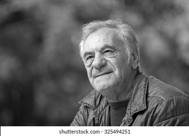 Black and white portrait of an handsome old man
