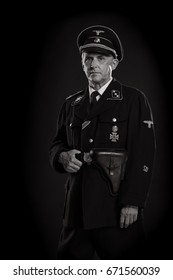 Black and white portrait Man actor in military uniform of the Second World War, posing on a black background