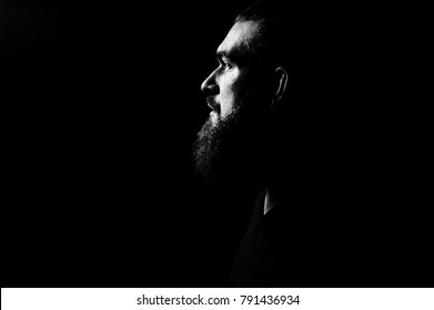 Black and white portrait. Man with long beard. Hipster profile portrait. Serious man silhouette. Open eyes. Looking forward.