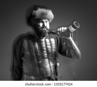 Black and white portrait of a man of the medieval warrior in chain mail with horn, a man close up with a cornucopia in hand, beard, long hair, Viking, Slavs, isolated on a dark background.