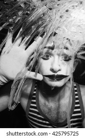 Black and white portrait of Mime behind the glass