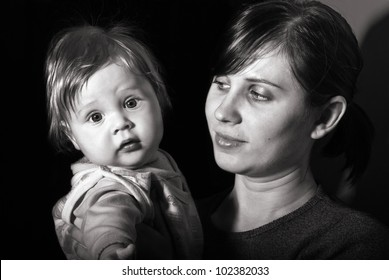 Black and white portrait mother with baby