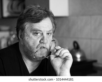 Black and white portrait of pensive mature man