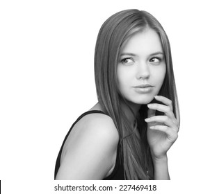 Black and white portrait of pensive young girl, isolated on white.