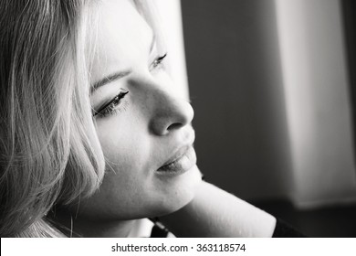 black and white portrait photograph of a beautiful blonde girl