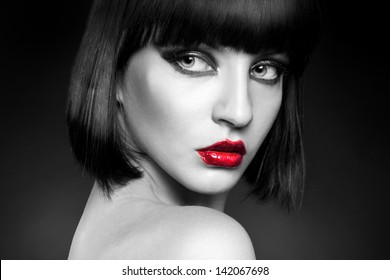 black and white portrait of pretty young brunette in studio