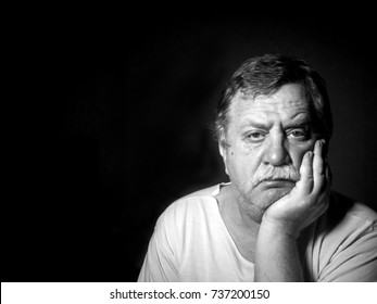 black and white portrait of sad middle-aged caucasian man