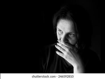 Black and white portrait of a sad woman