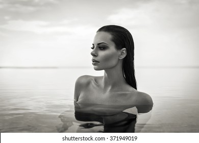 Black and white portrait of sexy model in pool