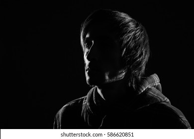 black and white portrait of the silhouette fashion model man
