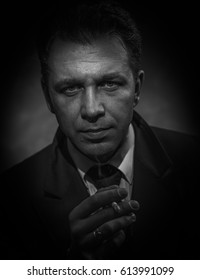 Black and white portrait of a smoking man