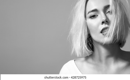 Black and white portrait woman with  short blond hair