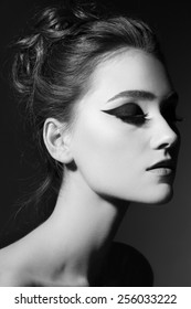 Black and white portrait of young beautiful girl with stylish cat eye makeup