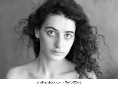 Black and white portrait of young beautiful girl. Fashion photo