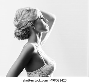 Black and white portrait of young and beautiful  bride. Close-up face of attractive girl with a blond hair.