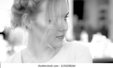 Black and white portrait of young girl with professional makeup, hairstyle