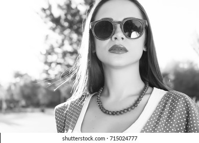 Black and white portrait of a young woman in a sarafan