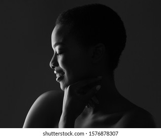 Black and white profile portrait of beautiful african american woman with short hair, closeup
