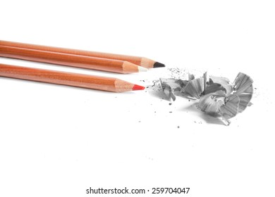 Black, white and red  pencils in white background
