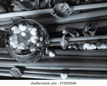 Black and white relax color wallpaper with candle hearts and petals on a striped background