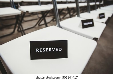 Black and white reserved sign. Reservation for seat at event.