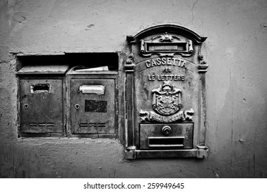Black and white retro letterboxes in Rome