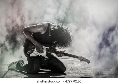 black and white rock star guitarist playing electric guitar
