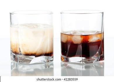Black and white Russian  cocktails. Ingredients: 5 oz vodka, 2 oz kahlua or 2 oz vodka, 1 oz kahlua, 1 oz milk