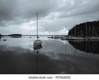 Black and White Sailboat on Lake Hartwell