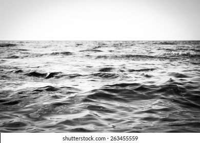 Black And White Seascape Of The Calm Kona, Hawaii Shoreline Waters Located On The Island Of Hawaii On A Bright, Sunny, And Tropical Beach Vacation Day