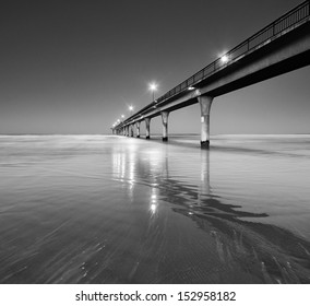 Black and White Seascape and Pier in New Brighton Beach, Christchurch, New Zealand.