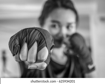Black and white Selected focus of young beautiful women wear a red Thai boxing tape ready for punching