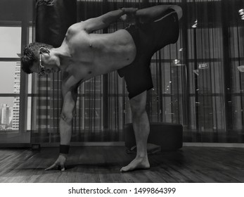 a black and white self portrait picture of man practicing your car in yoga studio Health Club Fitness