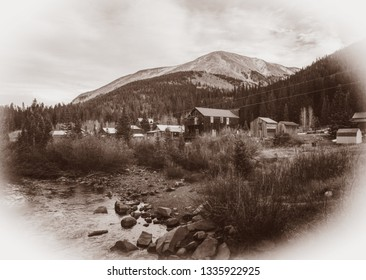 Black and White Sepia Vintage Photo of Old Western Wooden Buildings in St. Elmo Gold Mine Ghost Town in Colorado, USA hidden in mountains