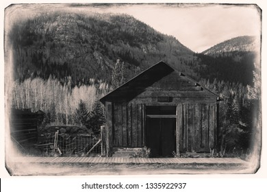 Black and White Sepia Vintage Photo of Old Western Wooden garage in St. Elmo Gold Mine Ghost Town in Colorado, USA hidden in mountains