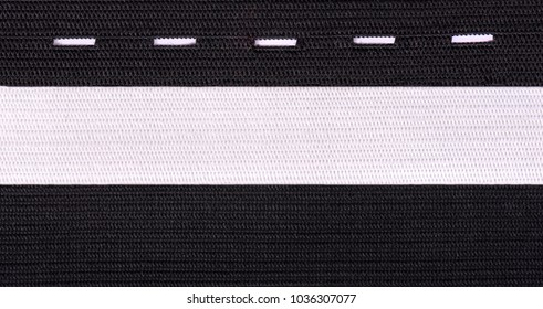 Black and white sewing elastic band isolated on white background. A variety of elastic bands for clothing and furniture.