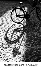 Black and white shadow of amsterdam bike
