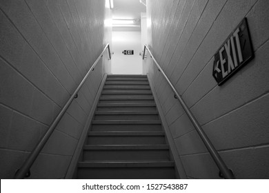 Black and white shot of a dark, empty stairwell